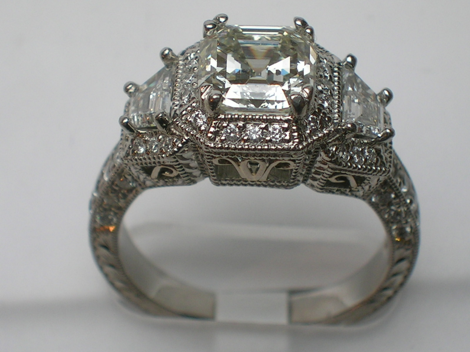 Platinum 3 Diamond With One 1 66ct Asscher I J Vs1 Diamond And 2 0 38tw Trillian G Vs1 Diamonds Egl Us Diana Michaels Jewelers